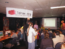An interested audience listens to Jaco van der Molen present LDraw via the projector.